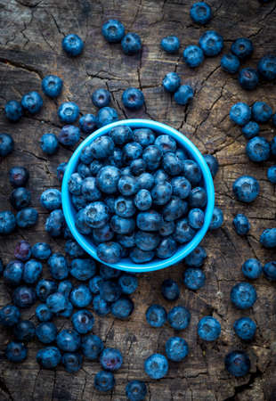 picked: Freshly picked blueberries on wooden background