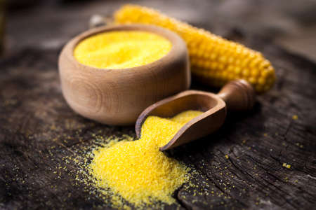 corn meal: Corn meal or dry polenta on vintage table Stock Photo