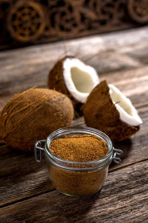 coconut palm sugar: Coconut palm sugar on rustic wooden background