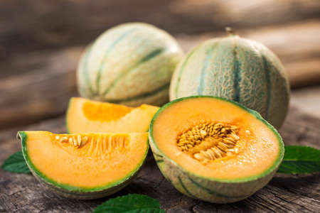 Fresh melons on wooden table