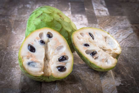 Cherimoyas on stone background