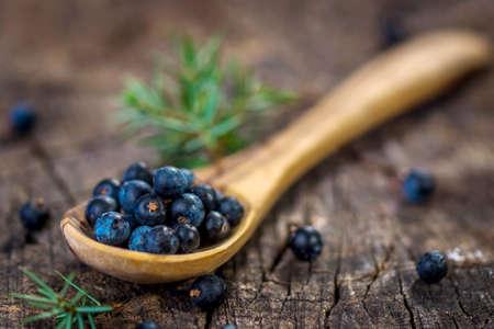 enebro: Juniper berries on old wooden table