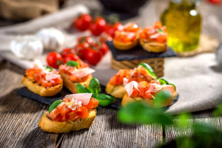 Tasty bruschetta with tomato,  basil, parmesan, olive oil ... Stock Photo