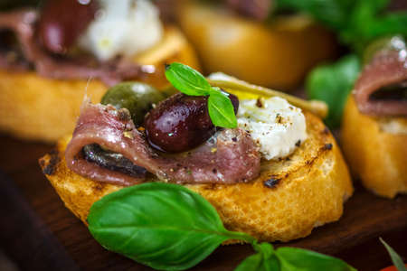 caper: Tasty bruschetta with anchovy, caper, olive oil ... Stock Photo
