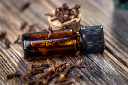 Clove essential oil and cloves aromatic flower buds
