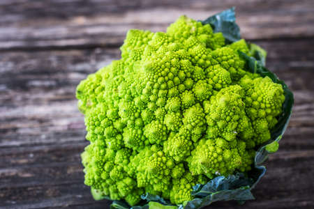 Romanesco cauliflower on wooden background