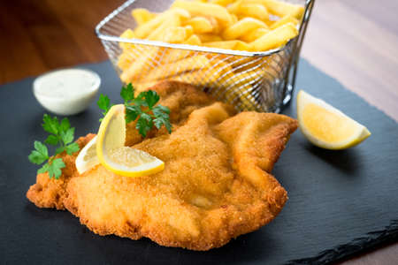 Wiener schnitzel with fried potatoes