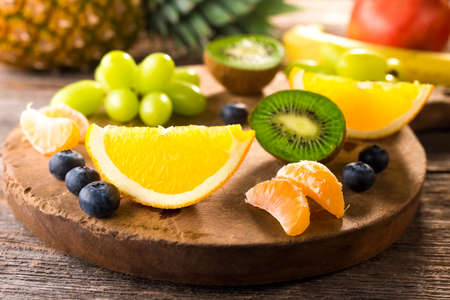 Fresh fruits on wooden background Stock Photo
