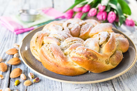 Sweet braided easter bread with marzipan and pistachio Archivio Fotografico