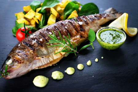 Grilled trout with potato and spinach Stock Photo - 96132038