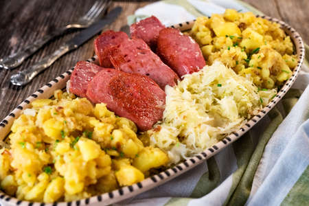 Leberkaese with sauerkraut and potato