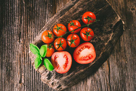 Fresh  tomatoes on rustic background