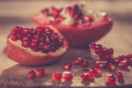 Pomegranate on wooden background Standard-Bild