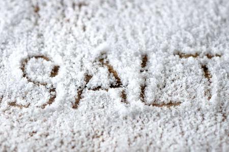 Salt on wooden background