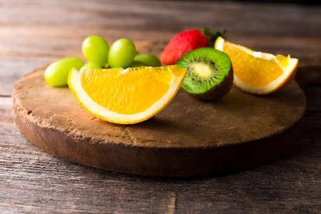 Fresh fruits on wooden background Standard-Bild