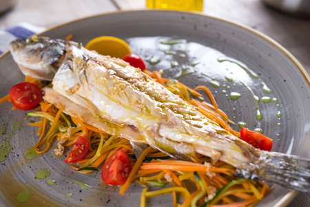 Cooked fish with vegetables
