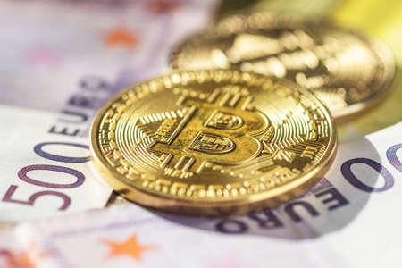 Bitcoins on euro banknotes background Standard-Bild