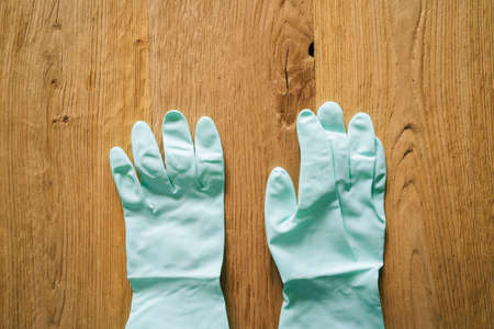 Just a protective latex gloves on a wooden background