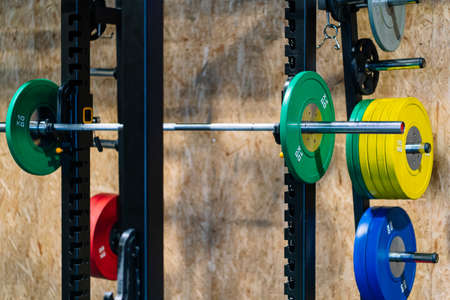 Colored dumbbells placed in the gym. High quality photoSeveral of different colors placed in the gym