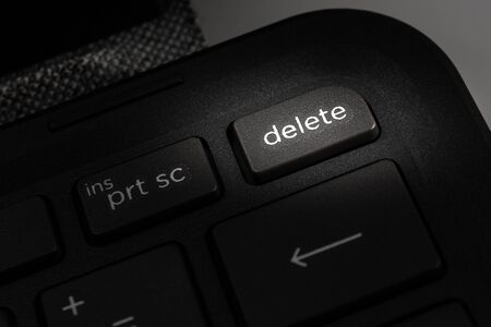 laptop computer keyboard with delete icon on the key, the concept of deleting information, cleaning the computer
