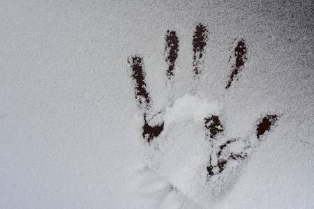 human handprints in the snow, concept of search for missing people Archivio Fotografico