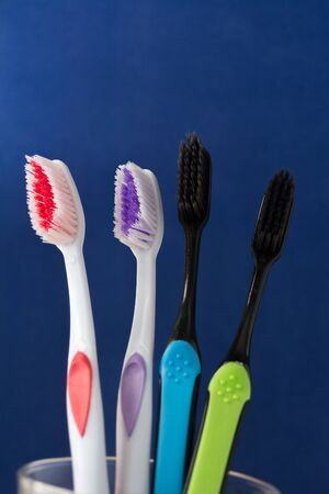 toothbrushes are multicolored on a bright blue background close-up