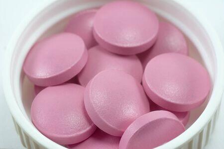pink pills close-up macro, meds