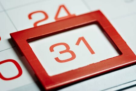 the thirty-first day of the month highlighted on the calendar with a red frame close-up macro, the mark on the calendar, the thirty-first date Banque d'images