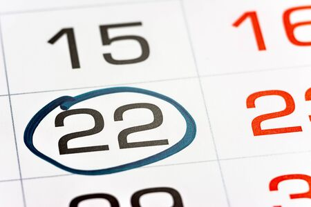 twenty-second day of the month highlighted on the calendar with a frame close-up macro, mark on the calendar, twenty-second date