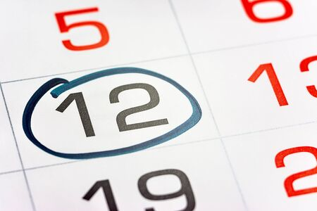 the twelfth day of the month highlighted on the calendar with a frame close-up macro, the mark on the calendar, the twelfth date