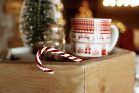 Christmas candy on the background of Christmas mug, Christmas mood, toned. Stok Fotoğraf