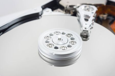 disassembled hard drive on white background, hdd, hard disk drive, close-up, head, object