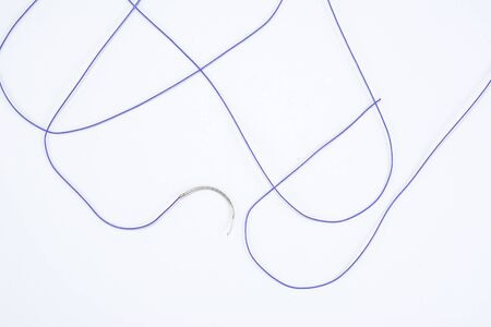 suture material close-up, thread for suturing wounds in medicine, dentistry, medical needle