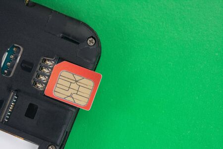 SIM card close-up next to the connector in the smartphone, phone