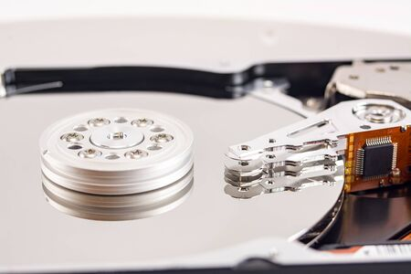 disassembled hard drive on white background, hdd, hard disk drive, close-up