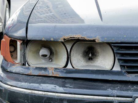broken car headlight close-up, broken lamp