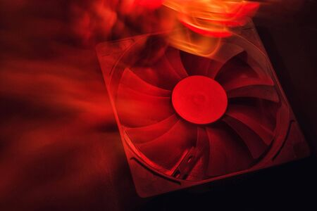 computer fan on black background. fire red