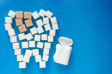 the carious tooth of sugar cubes of refined sugar, preventing tooth decay, caring for the health of your teeth, the causes of caries