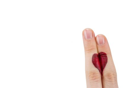fingers coupled together with drawn heart, isolated on white background, symbol of love, relationship