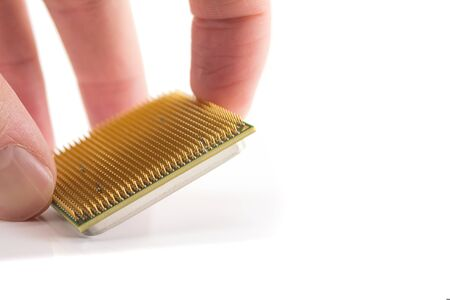 computer CPU in hand close-up isolated on white background