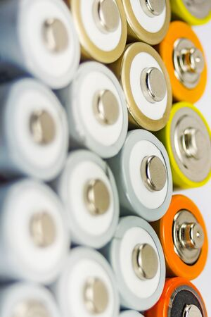 alkaline batteries multi-colored metal and the positive side of the AA-size, closeup, carbon zinc, rechargeable batteries
