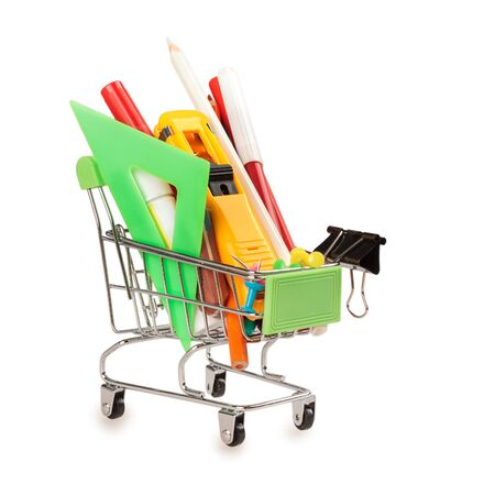 shopping cart with office school tools, the concept of education and office working