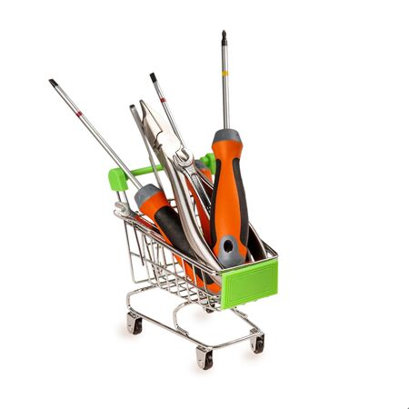 shopping cart with construction tools, the concept of repairing with your own hands and purchasing tools