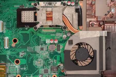 laptop cooling system close-up with rotating fan, CPU cooling and overheating, trottling