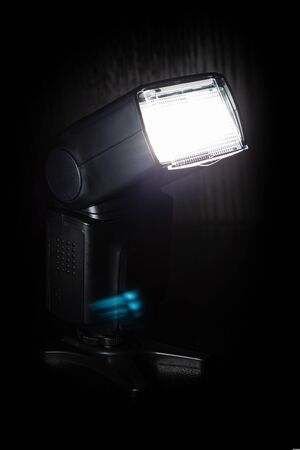 flash while working on a dark background, photo equipment, external flash
