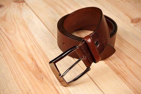 leather men's trouser belt on wooden background