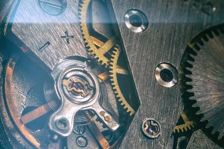 vintage old mechanism with gears and springs, clock mechanism close-up macro