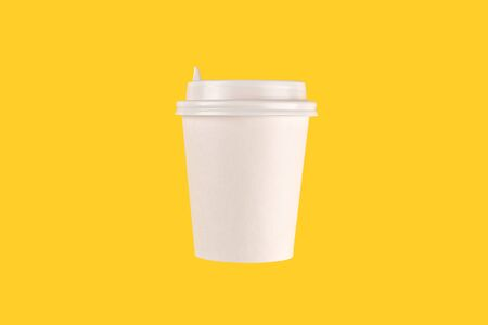 coffee cup cardboard disposable isolated on yellow background, coffee to go, takeaway