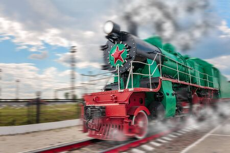 vintage steam train hurtling at speed along the rails, retro vehicle, steam engine