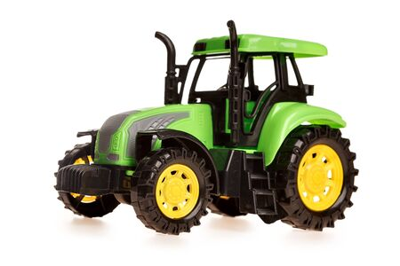 childrens toy small green toy tractor isolated on white background Zdjęcie Seryjne